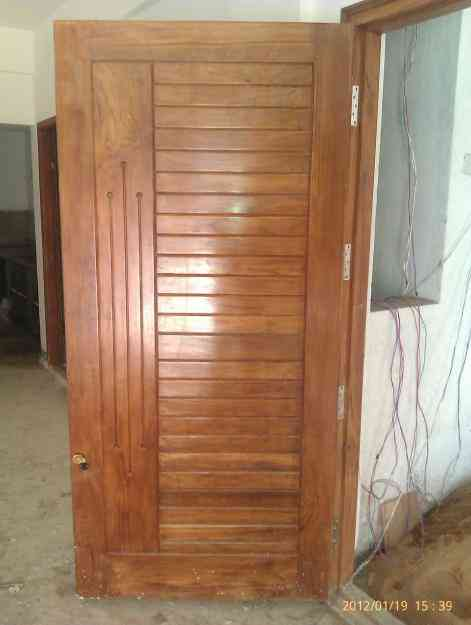 Brand new teak main door panels designed above block board for Teak wood doors in bangalore